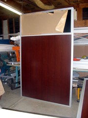 office panel with wood grain laminate surface and tinted window