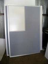 office partition with dry erase board in upper corder